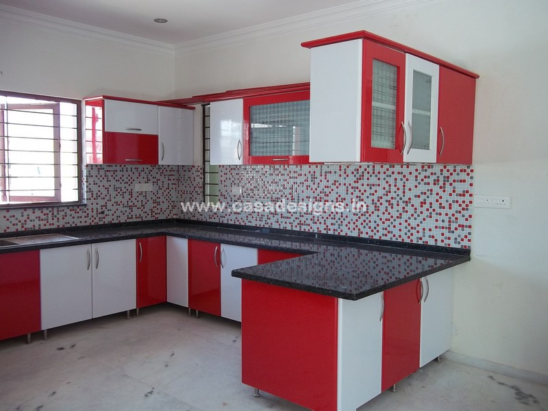 Casa designs perfect choice for your home office interiors for Modular kitchen designs red white